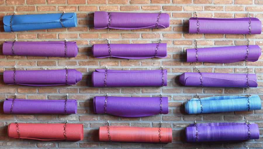 Wall of yoga mats in a yoga studio